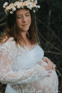Tallahassee maternity photographers Mom outside with crown side view