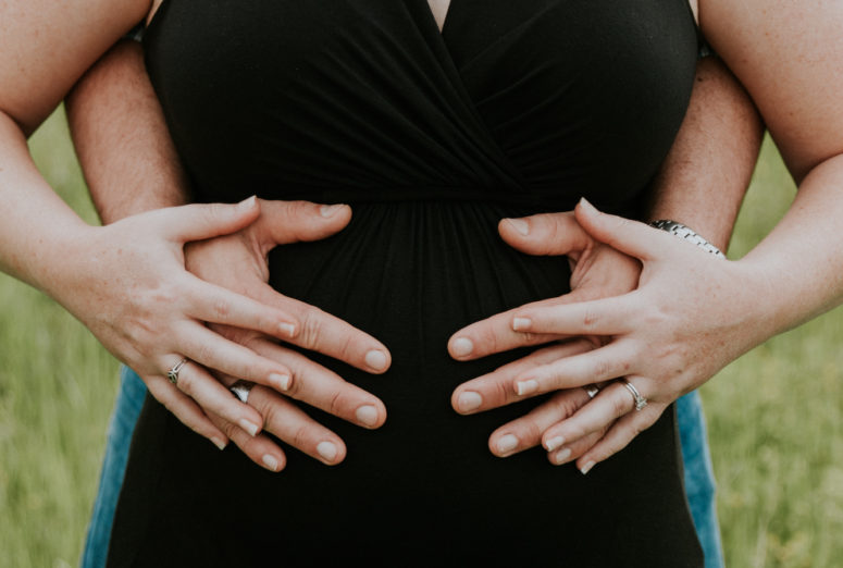 Tallahassee Maternity Photographer Mom and dad with hands on belly