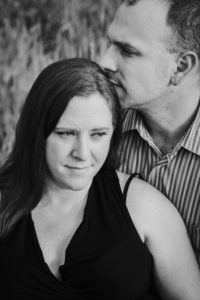 Tallahassee Maternity Photographer Dad Kissing Mom