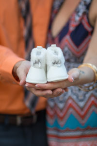Tallahassee Family Photographer Maclay Gardens Parents holding Baby shoes