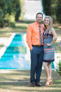 Catalytic Camera Photo Tallahassee Family Photographer Maclay Gardens new parents standing in front of reflection pool