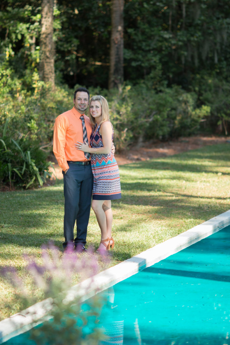 Catalytic Camera Photo Tallahassee Family Photographer Maclay Gardens new parents standing to side of reflection pool