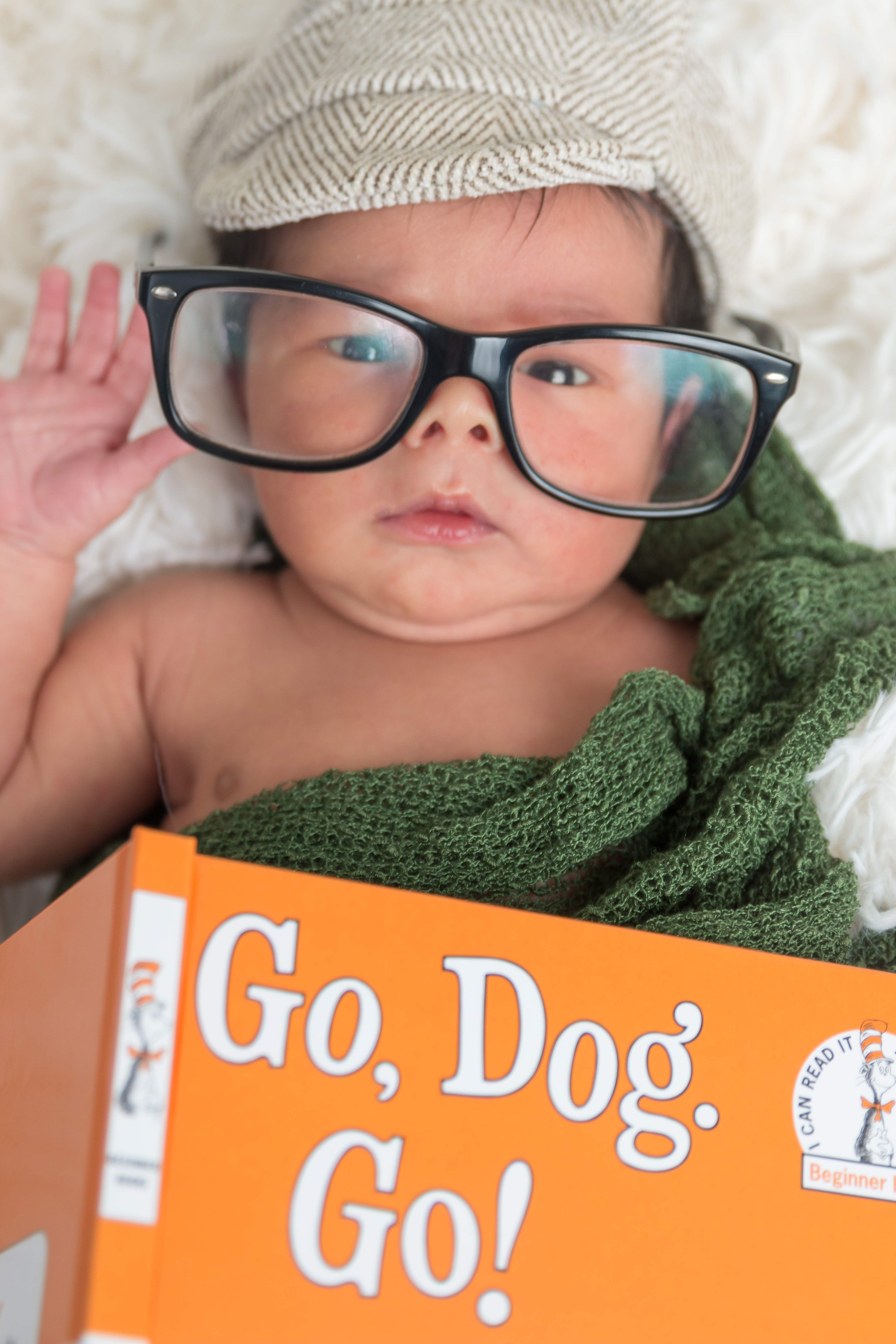 Tallahassee newborn photographer Catalytic Camera Baby with a book and glasses