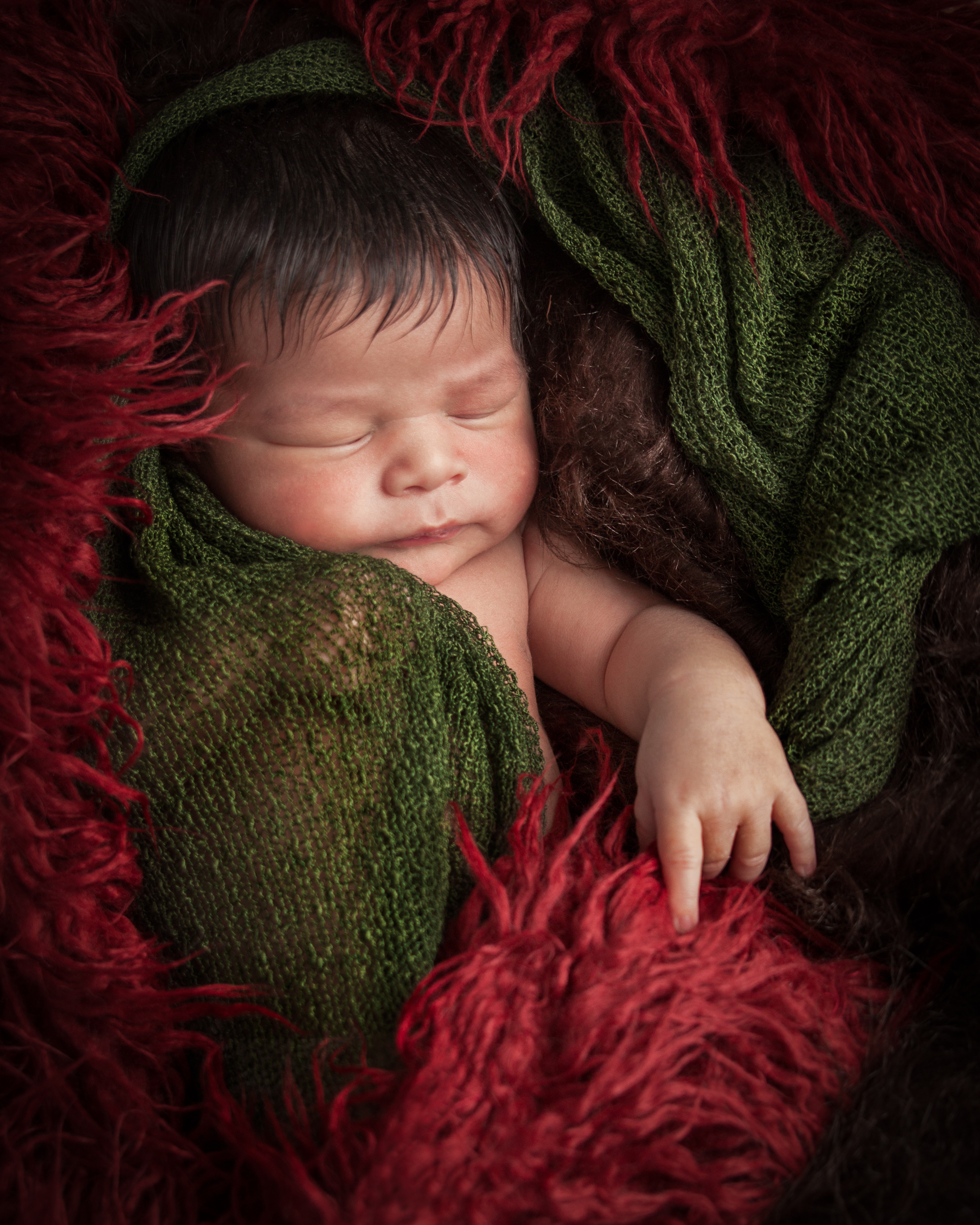 Baby asleep with neutral earth tone colors