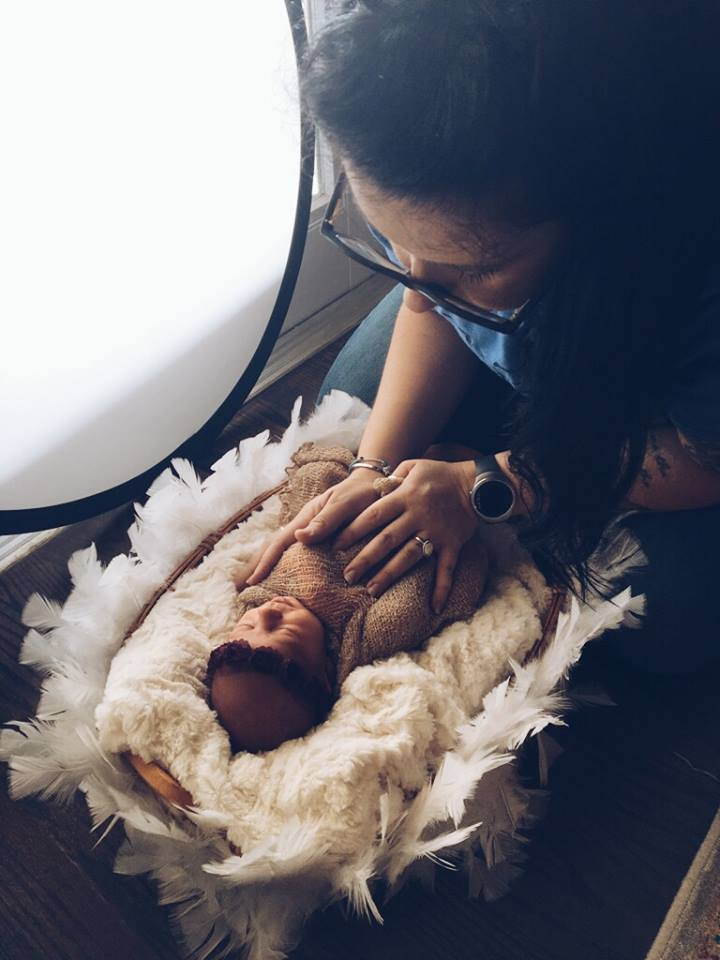 Amanda Thomas working with newborn for photoshoot