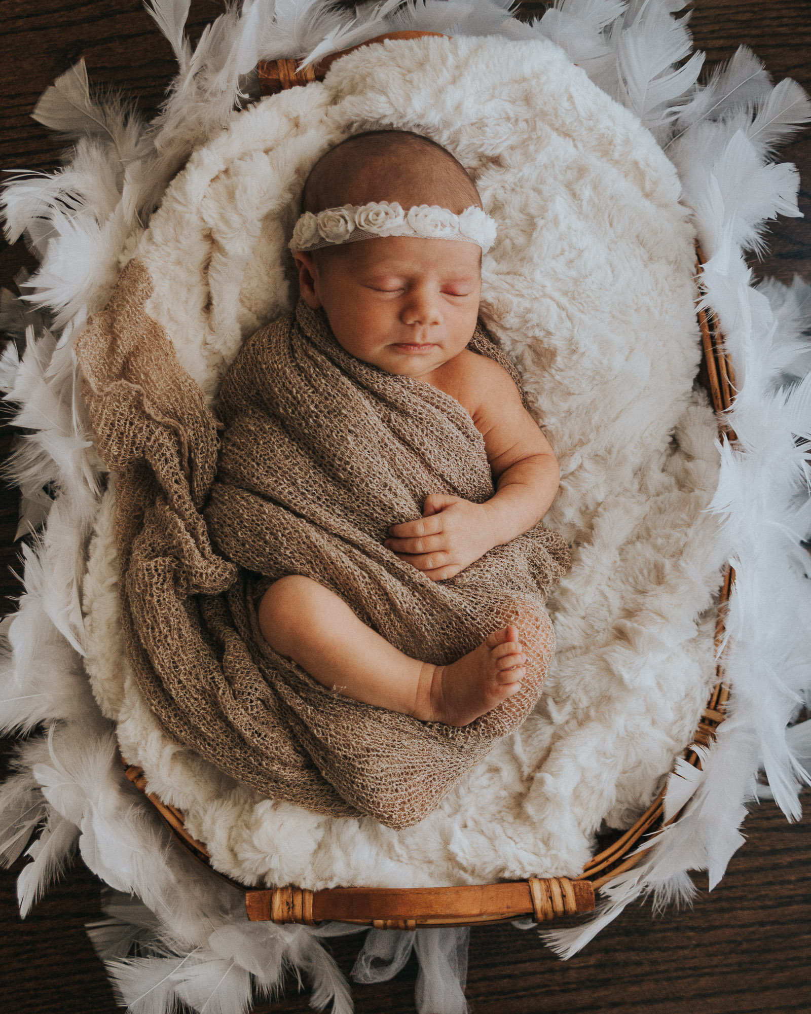 Newborn photographer on location in home Baby with headband